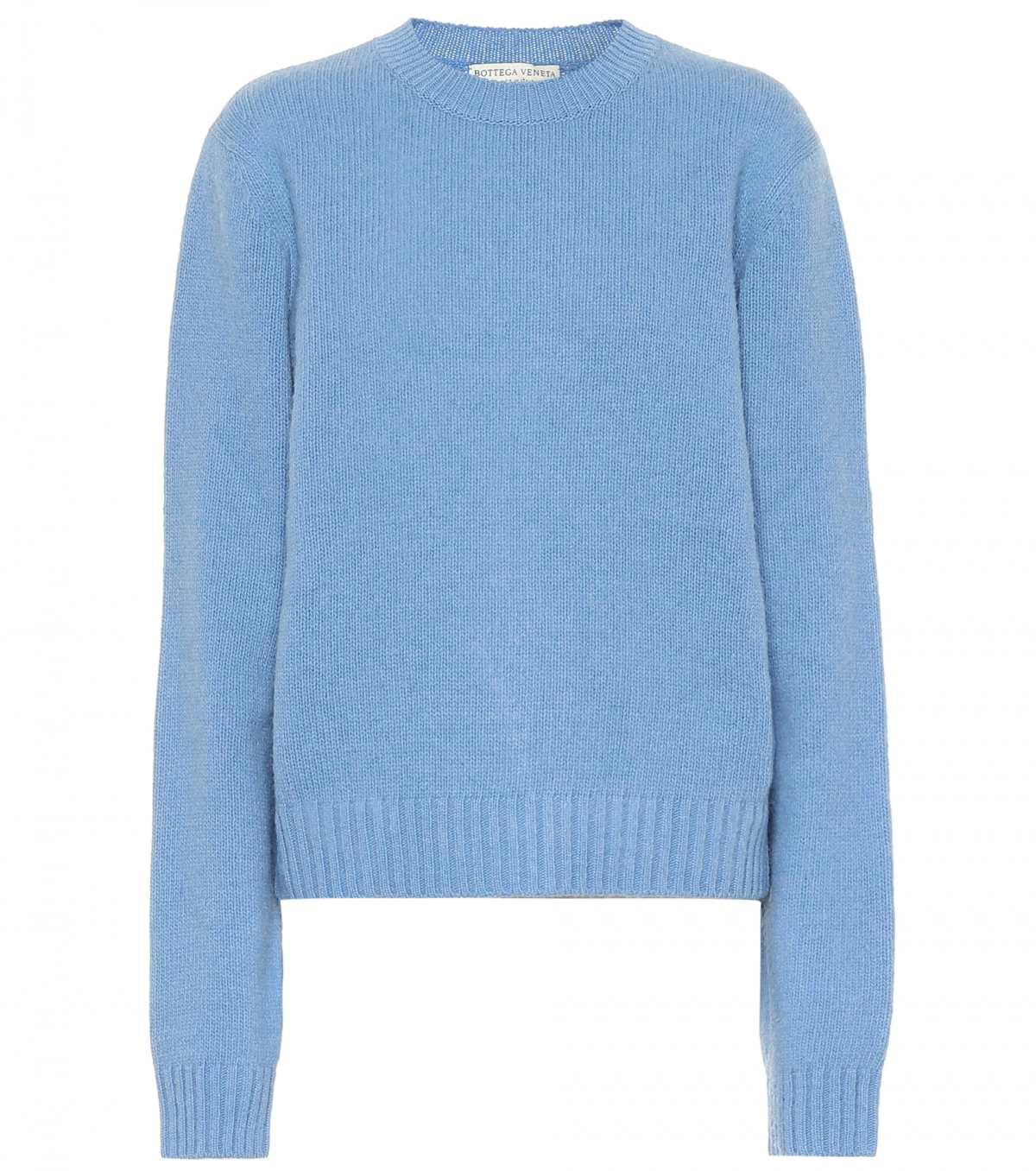 Kendall Jenner donning a Pale blue Bottega Veneta woolen sweater with a woolen material and a mandarin neck