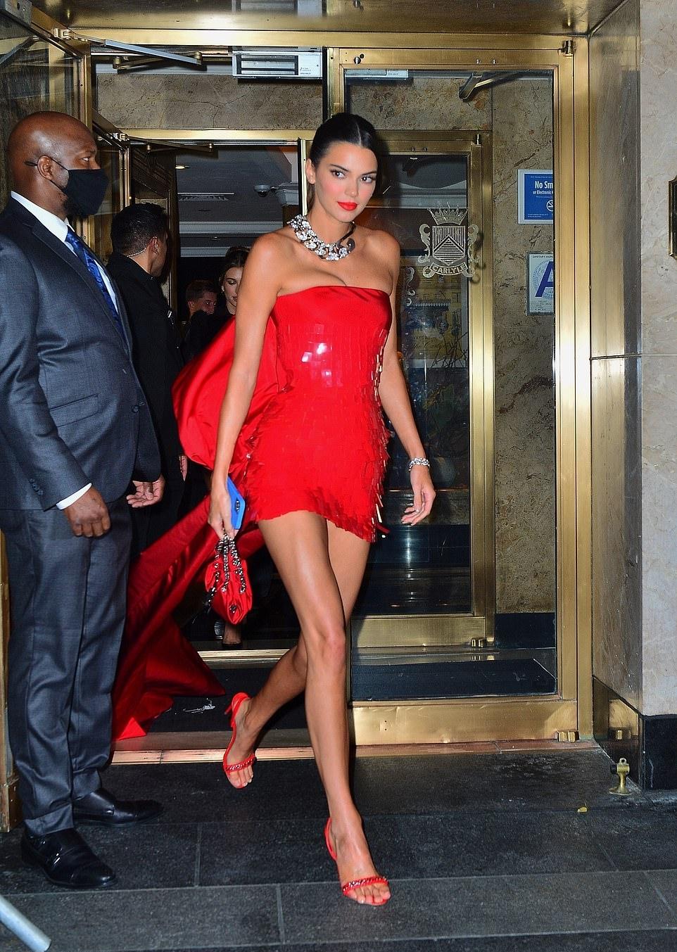 Kendall Jenner donning embellished red slingback sandals with stiletto heels
