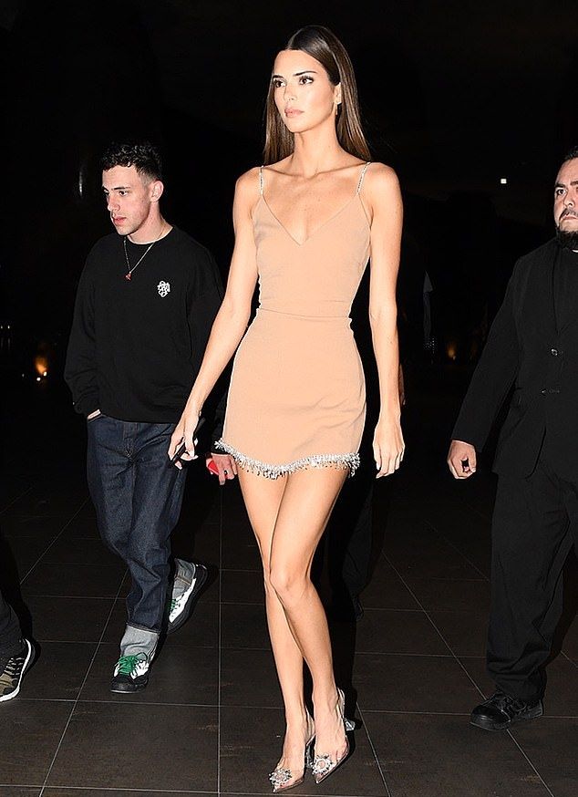 Kendall Jenner wearing a Formfitting nude dress with a V-neck and sparkling straps