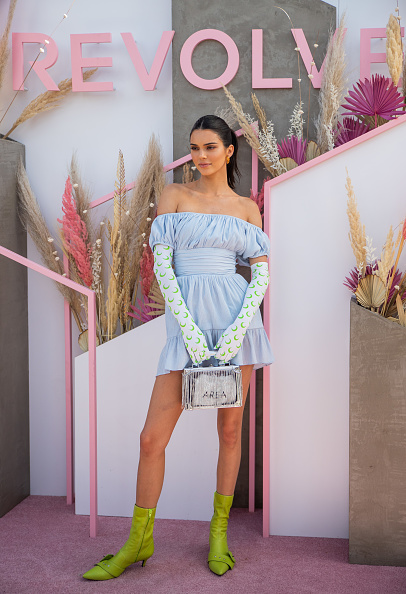 Kendall Jenner wowed in a ruched light blue off-shoulder dress with elastic juliet sleeve, pleated, a elastic neckline and cinched waist