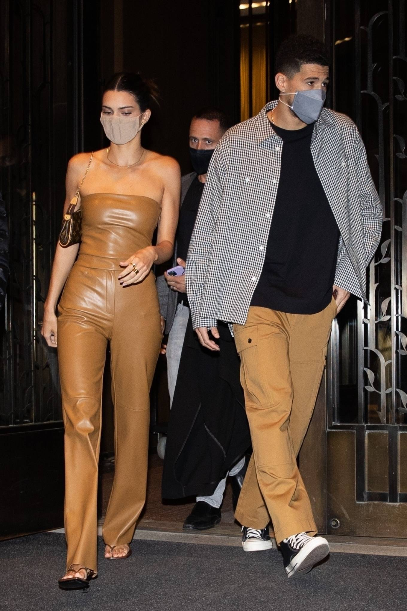 Kendall Jenner wearing square brown slip on sandals with kitten heel