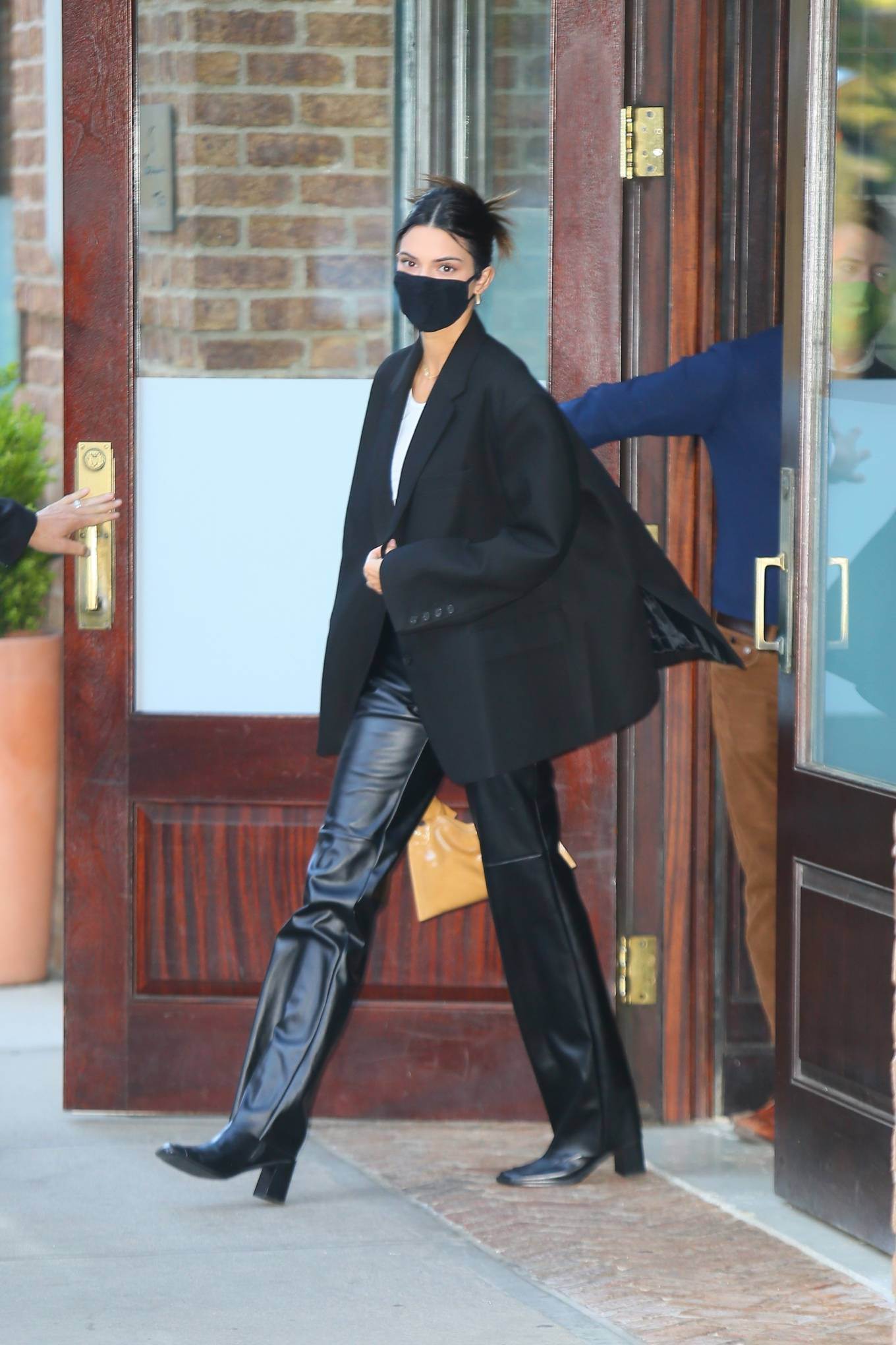 Kendall Jenner rocking classic black boots with block heel
