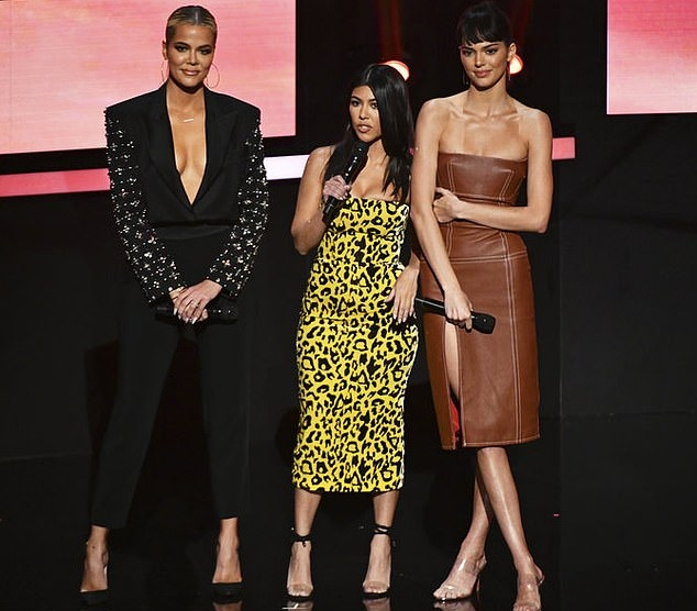 Kendall Jenner donning a Formfitting tan leather dress with a leather fabric and piping
