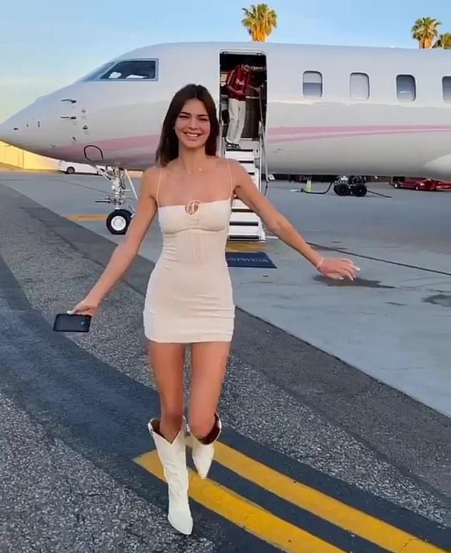 Kendall Jenner rocking a Figure hugging white mini dress with cut out and spaghetti straps