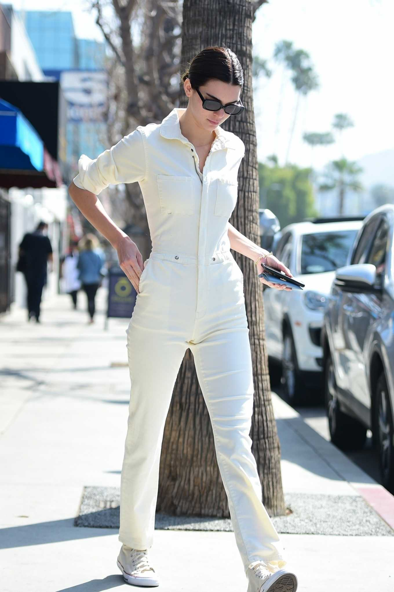 Kendall Jenner donning round white Converse ankle canvas shoes