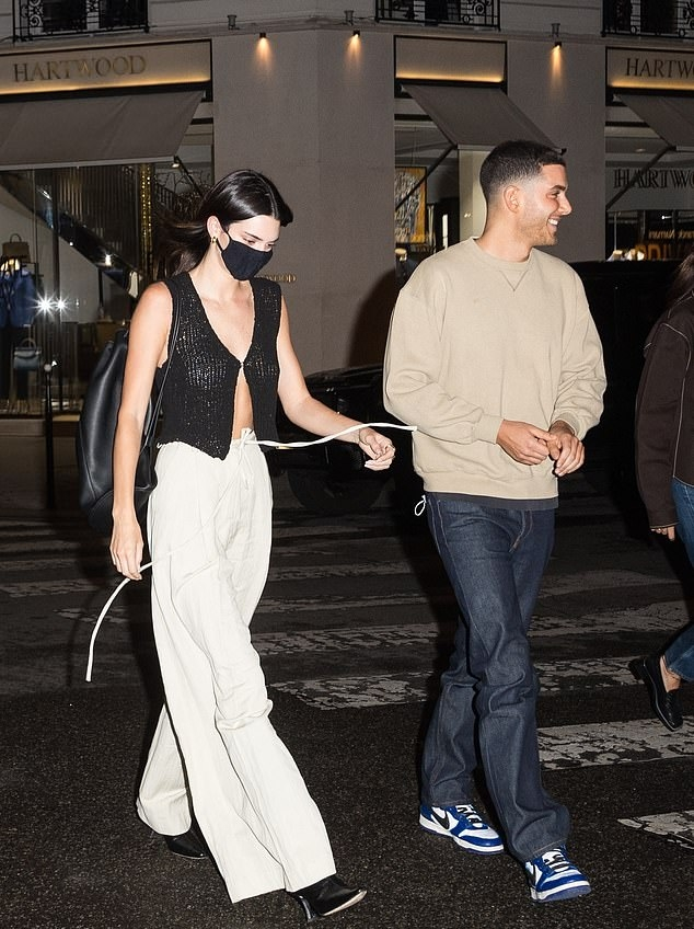 Kendall Jenner donning pointed black boots with high heel