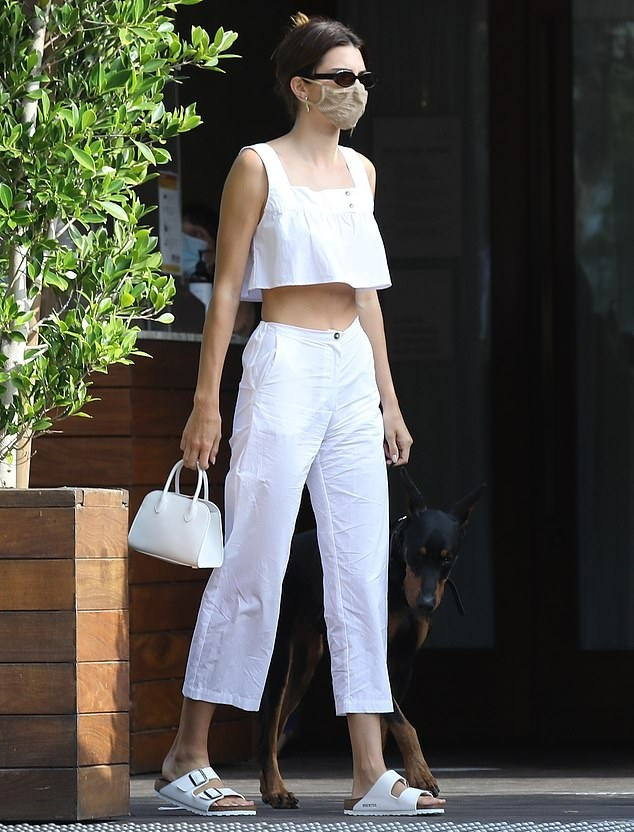 Kendall Jenner rocking white rubber open toe sandals while arriving at the Soho House in Malibu