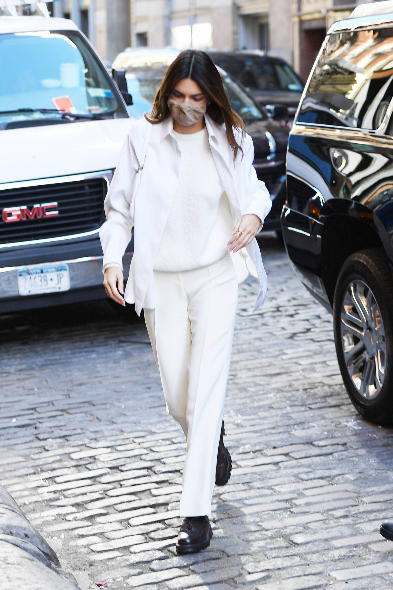 Kendall Jenner wearing Straight fit white Musier Paris high rise trousers
