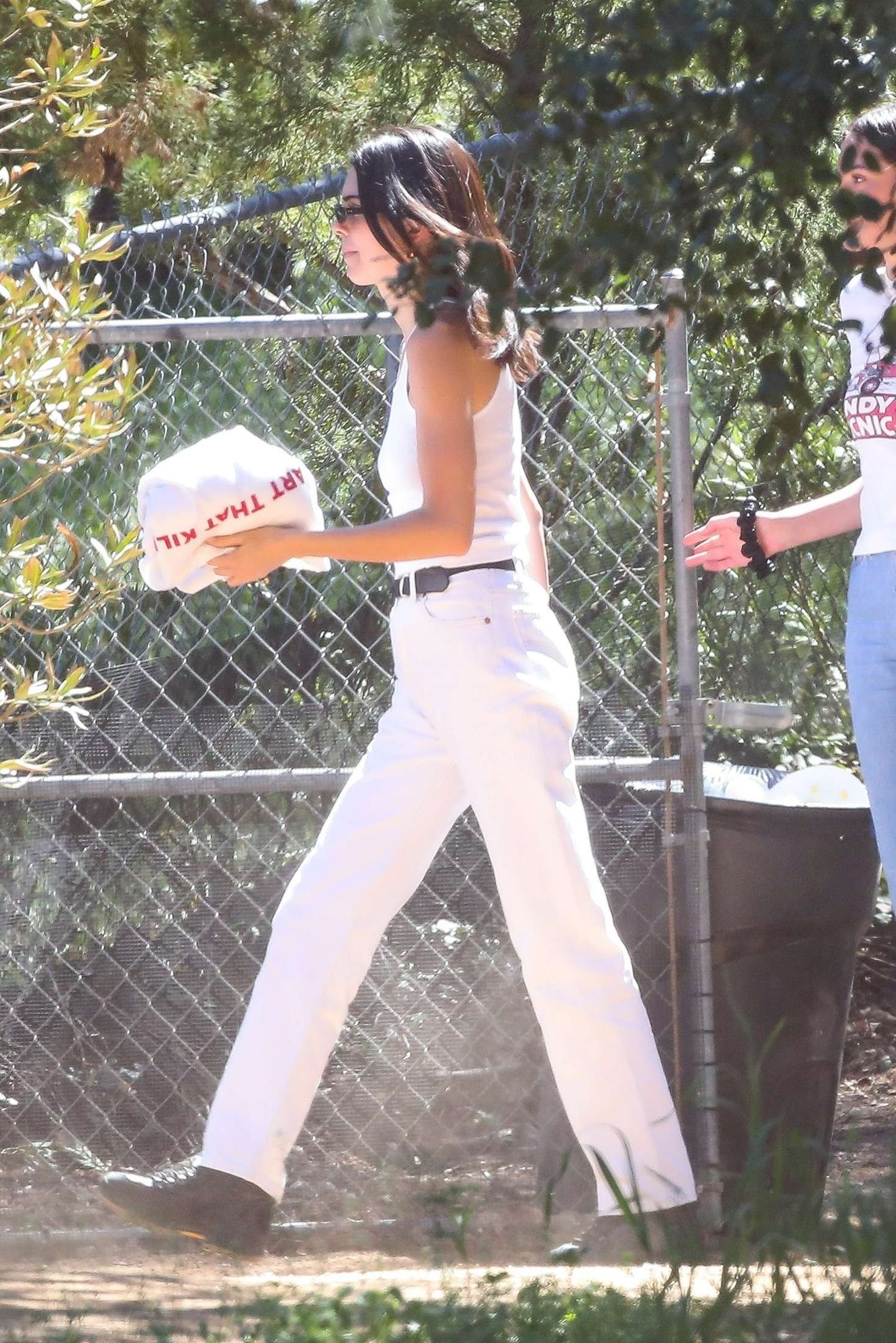 Kendall Jenner rocking straight fit white denim high rise ankle length jeans with side pockets