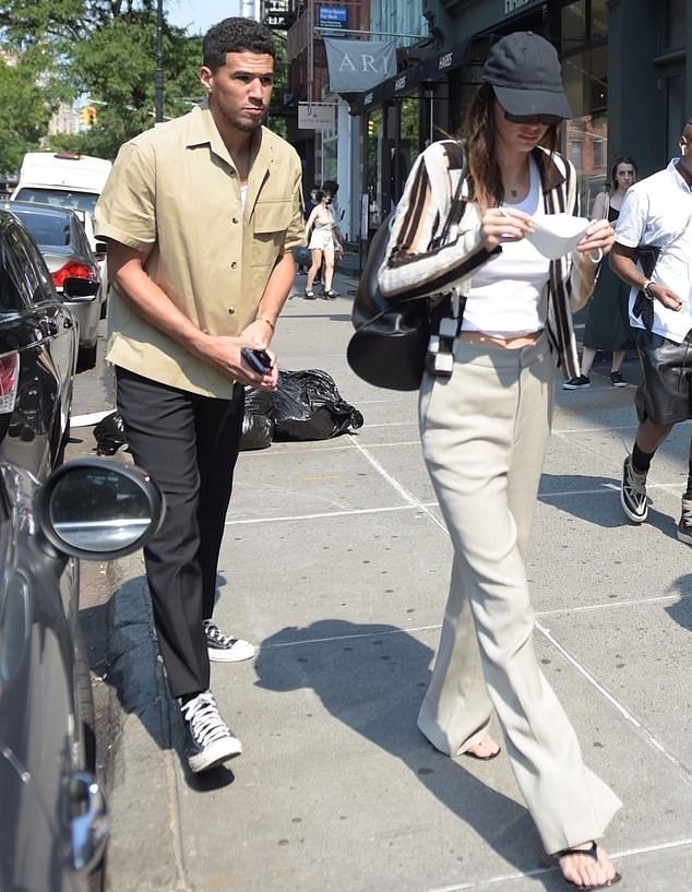 Kendall Jenner wearing square black slip on sandals by Simon Miller with kitten heel