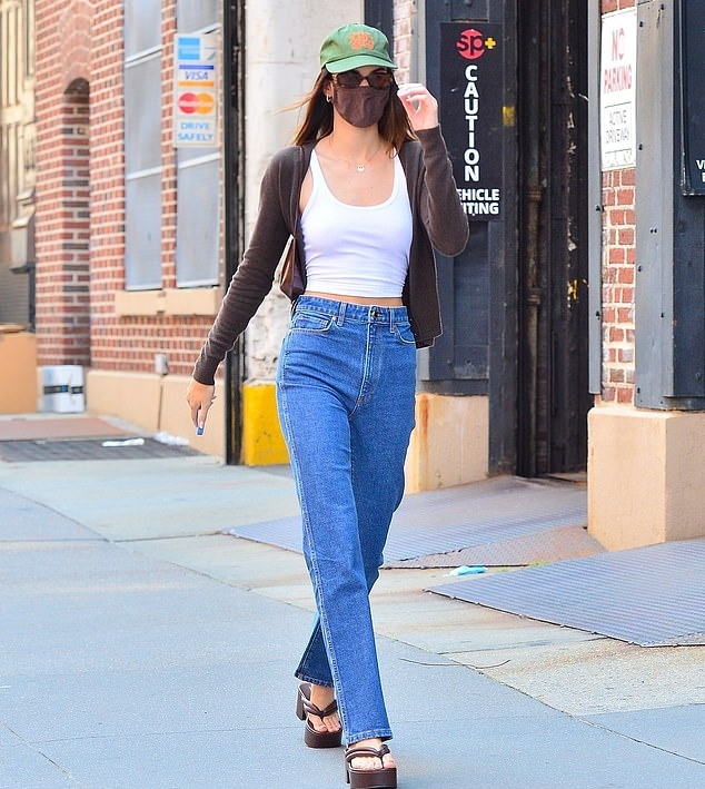Kendall Jenner wearing round brown leather slip on sandals by Dries Van Noten with platform heels