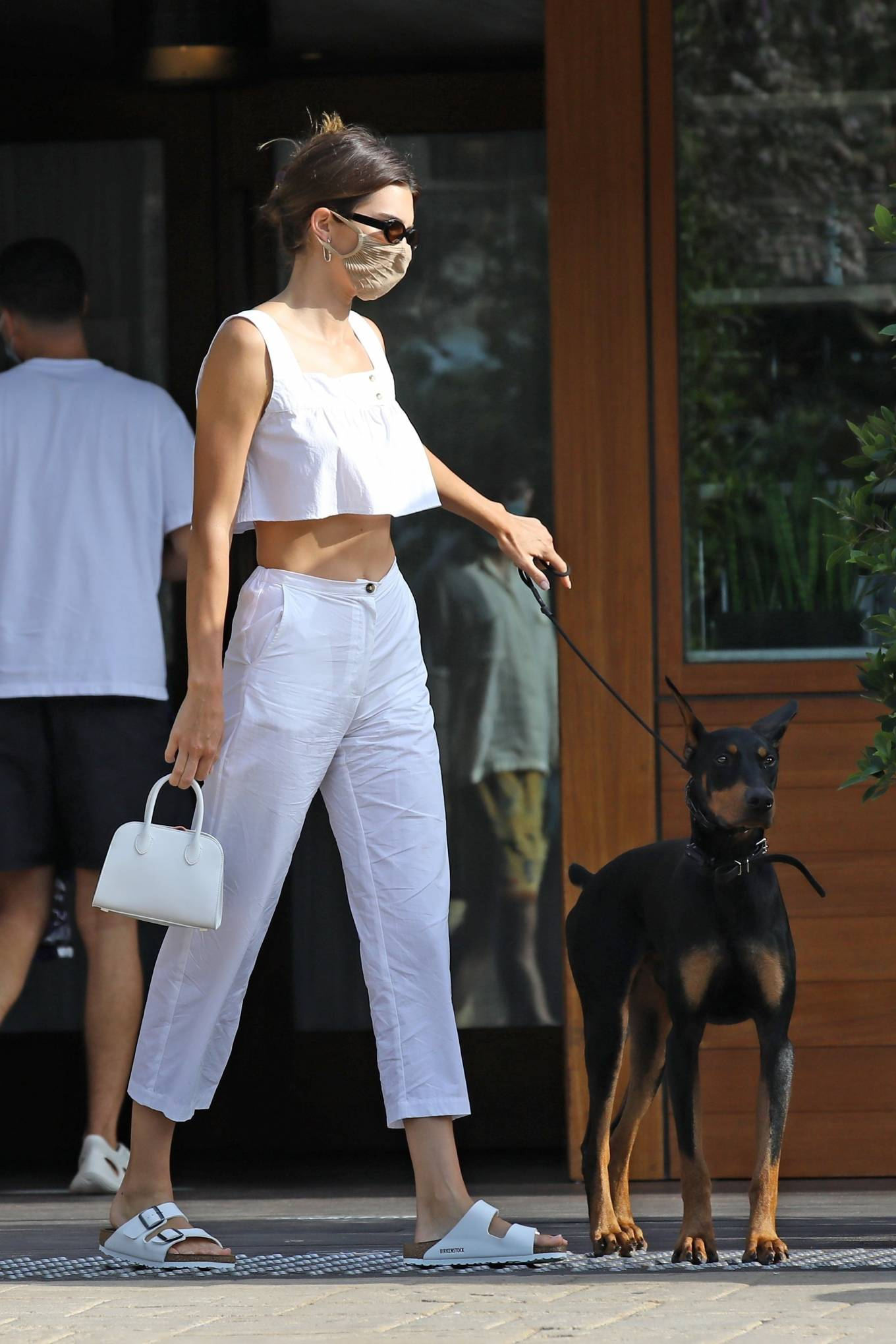 Kendall Jenner rocking white rubber open toe sandals with buckled ankle strap