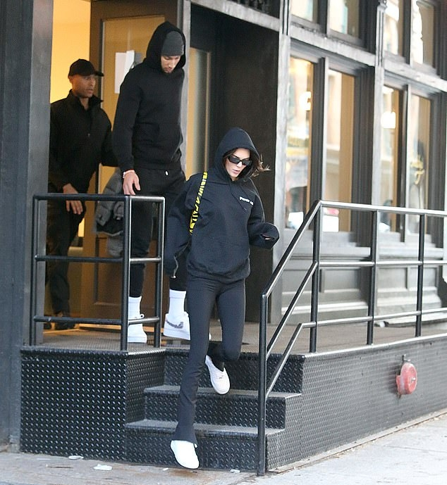 Kendall Jenner donning white lace-up sneakers