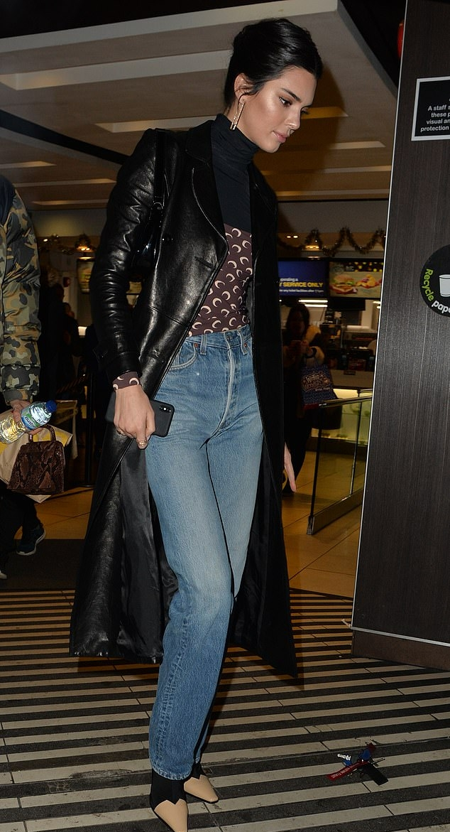 Kendall Jenner donning narrow beige leather pumps with high heel