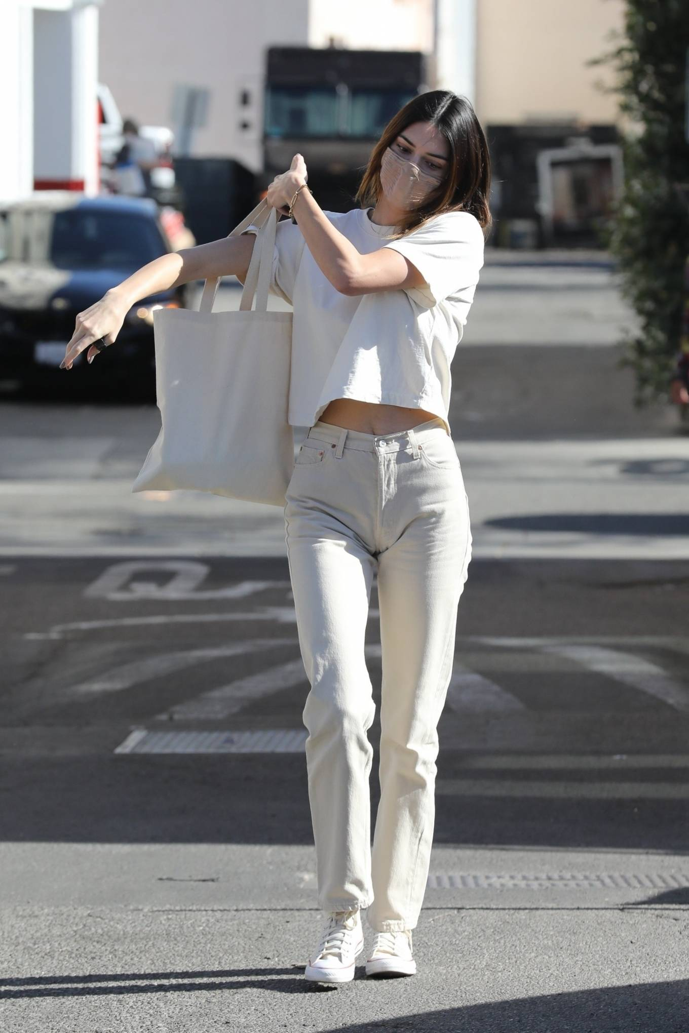 Kendall Jenner rocking round beige white lace-up sneakers by Nordstrom with flat heel
