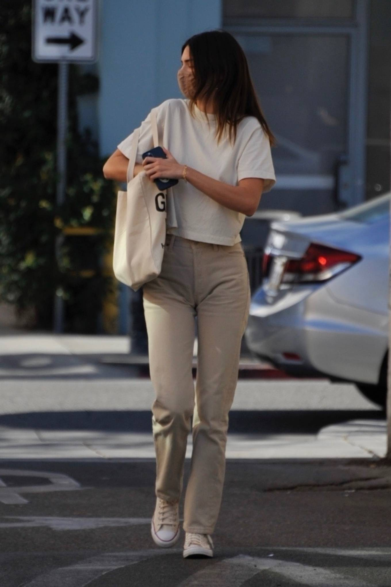 Kendall Jenner donning a relaxed fit white crop top while going to have lunch