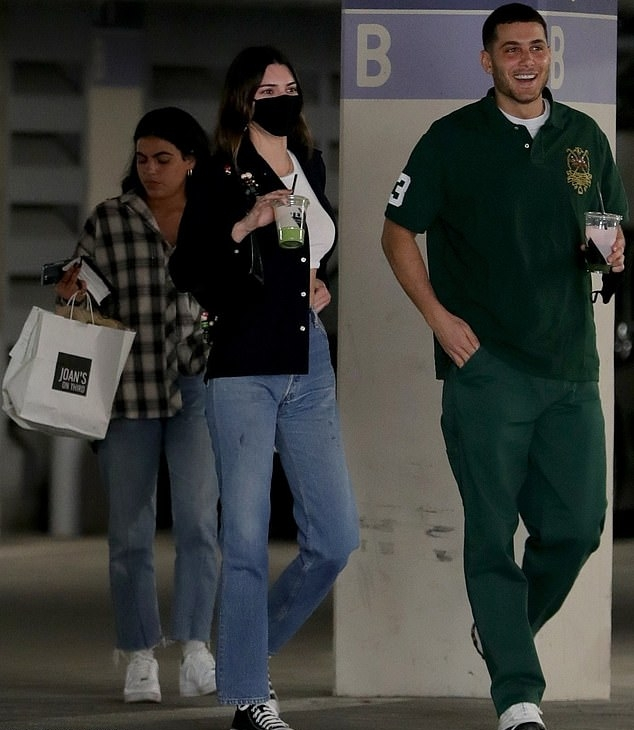 Kendall Jenner donning round black white lace-up sneakers by Converse while out and about in Lacma museum in LA