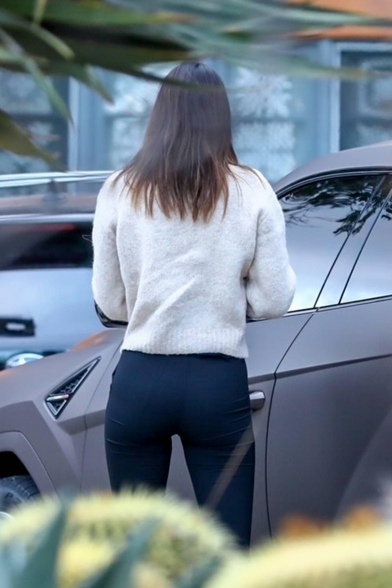 Kendall Jenner wearing black leggings with side pockets