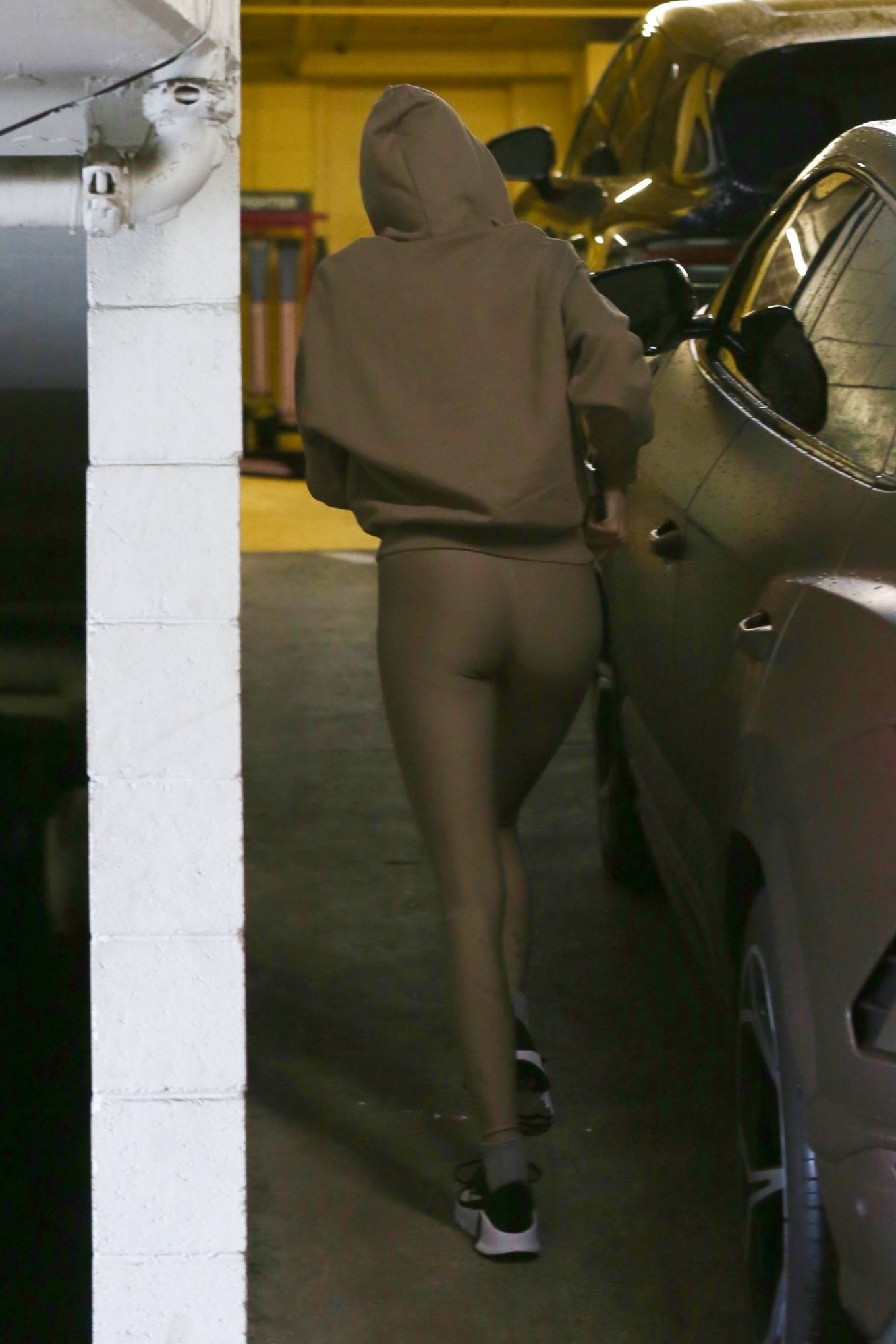 Kendall Jenner rocking a relaxed fit brown hoodie while heading to pilates class in West Hollywood