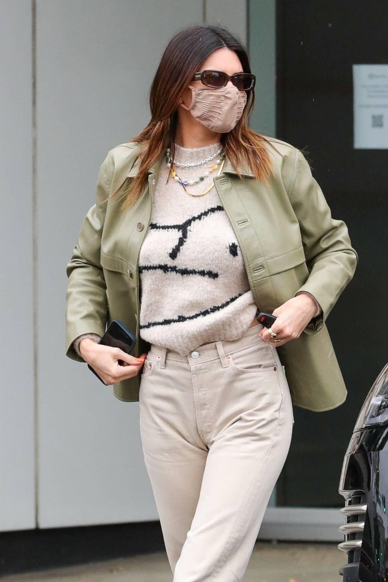 Kendall Jenner donning a relaxed fit off white sweater while heading to have breakfast