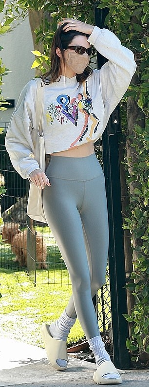 Kendall Jenner donning skinny grey high waist workout leggings