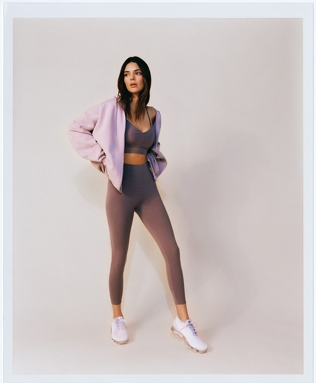 Kendall Jenner donning a oversized lilac hooded hoodie with a fleece material, full sleeves and drawstring
