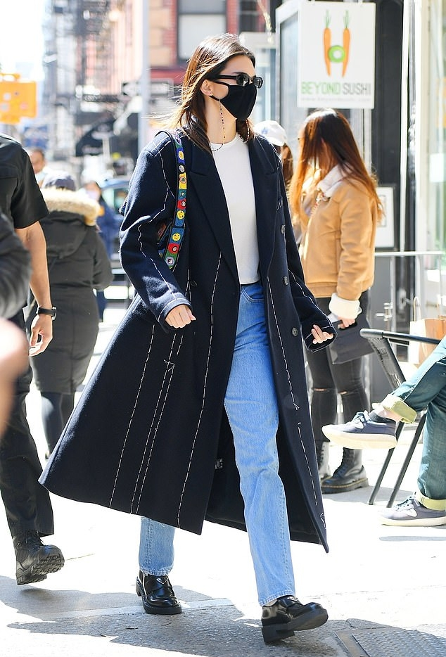Kendall Jenner wearing brand logo black leather slip on loafers with cuban heel