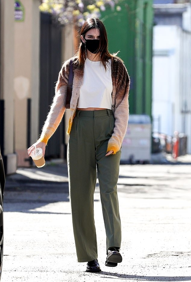 Kendall Jenner wearing round black slip on loafers with flat heel
