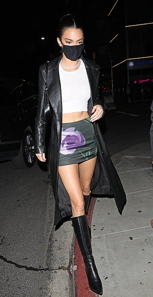 Kendall Jenner rocking a fitted white crop top with a round neck