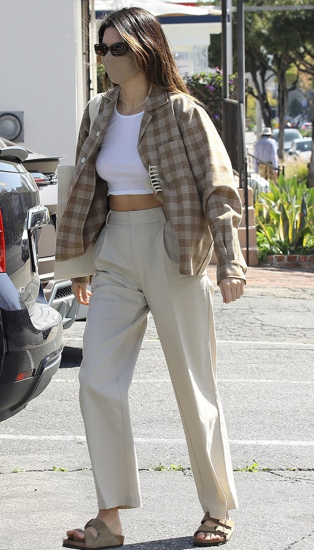 Kendall Jenner rocking round brown Nude slip on slippers by Birkenstock with flat heel and wide strap