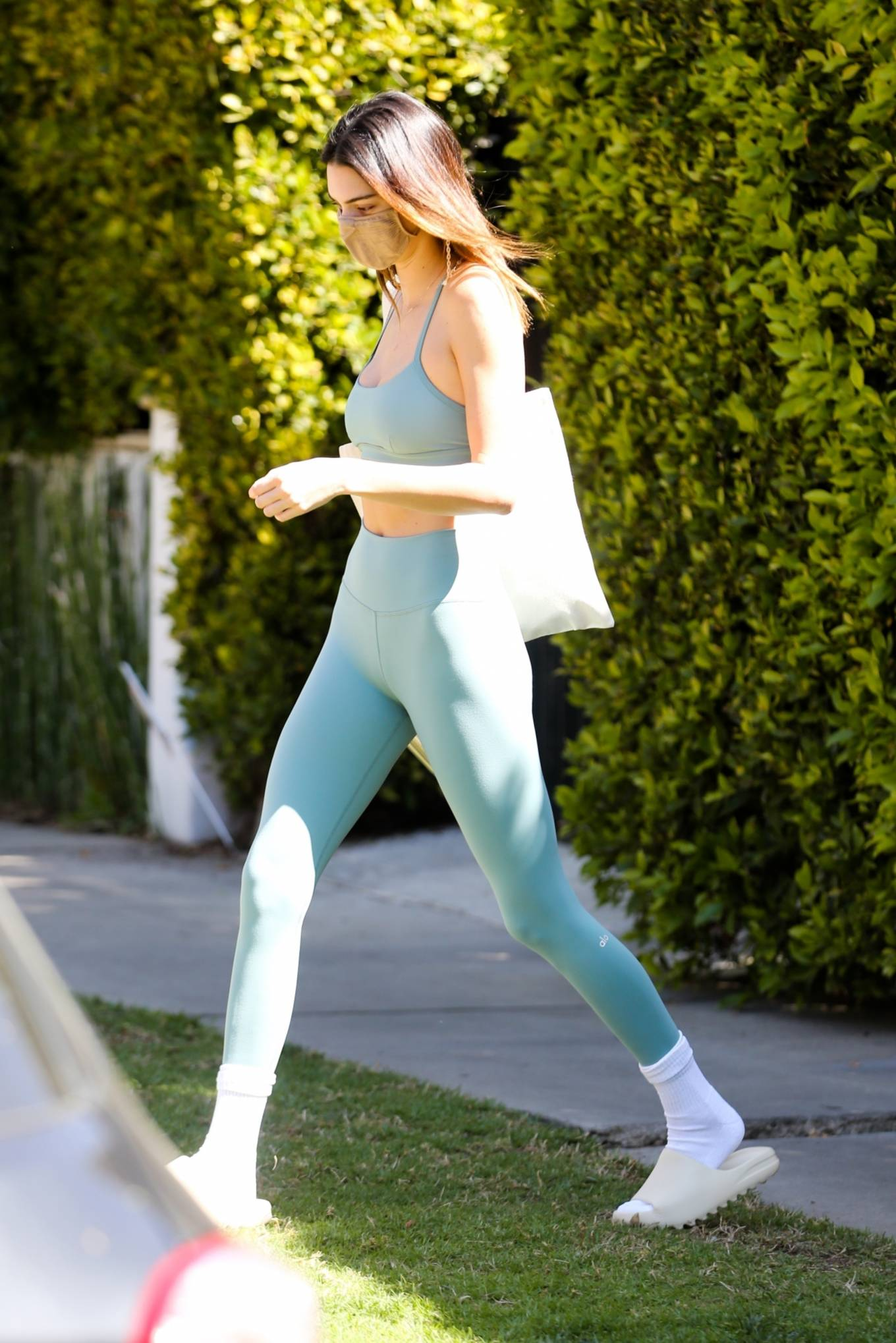 Kendall Jenner rocking a blue lettering sweater with full sleeves