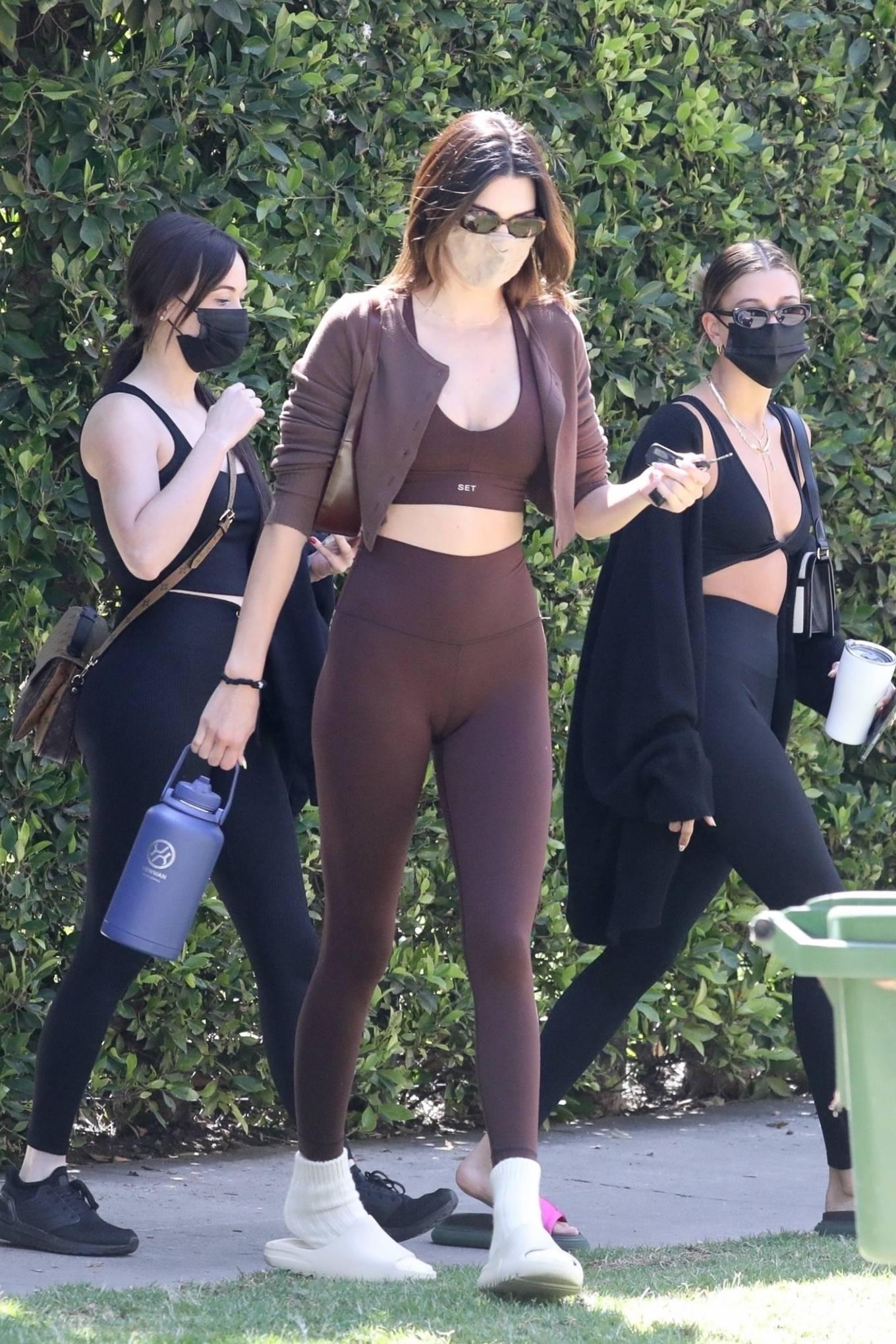 Kendall Jenner donning figure hugging brown high waist workout leggings