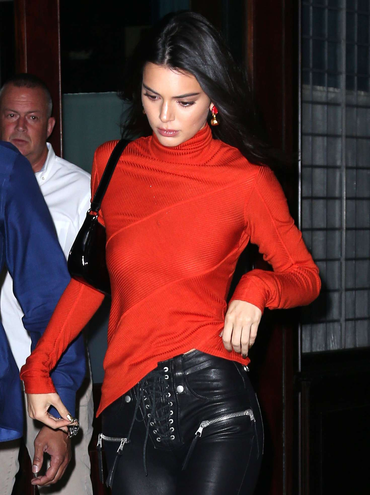 Kendall Jenner wearing a Sheer Dark Orange Red Top, With High Neck and Asymmetric Hem ,While Going Braless, to Bella Hadid's 22nd Birthday Party, in New York.
