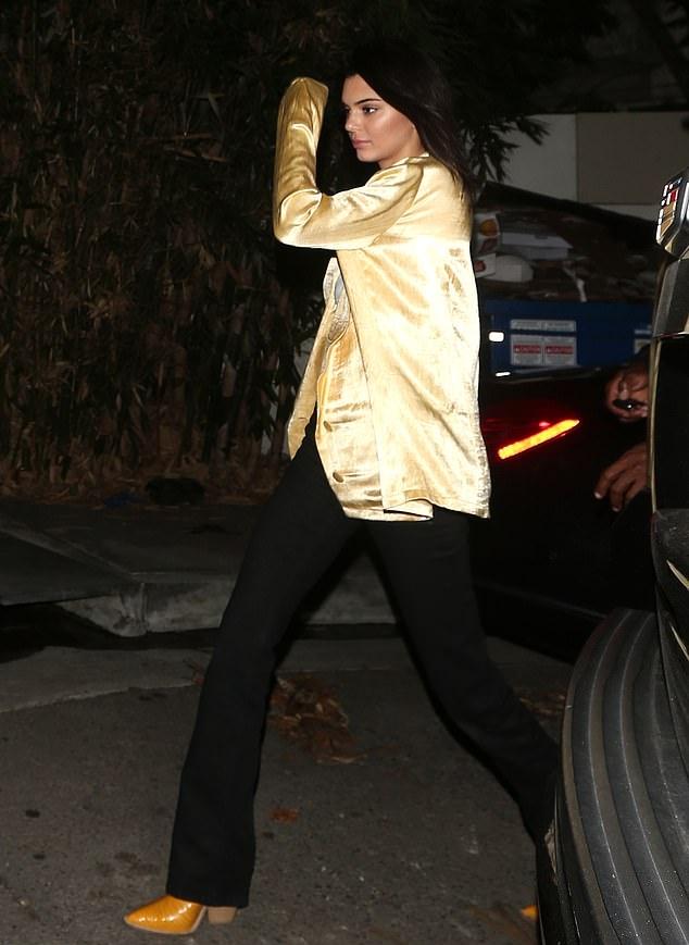 Kendall Jenner Yellow narrow yellow Fendi ankle cowboy boots skinny black denim jeans