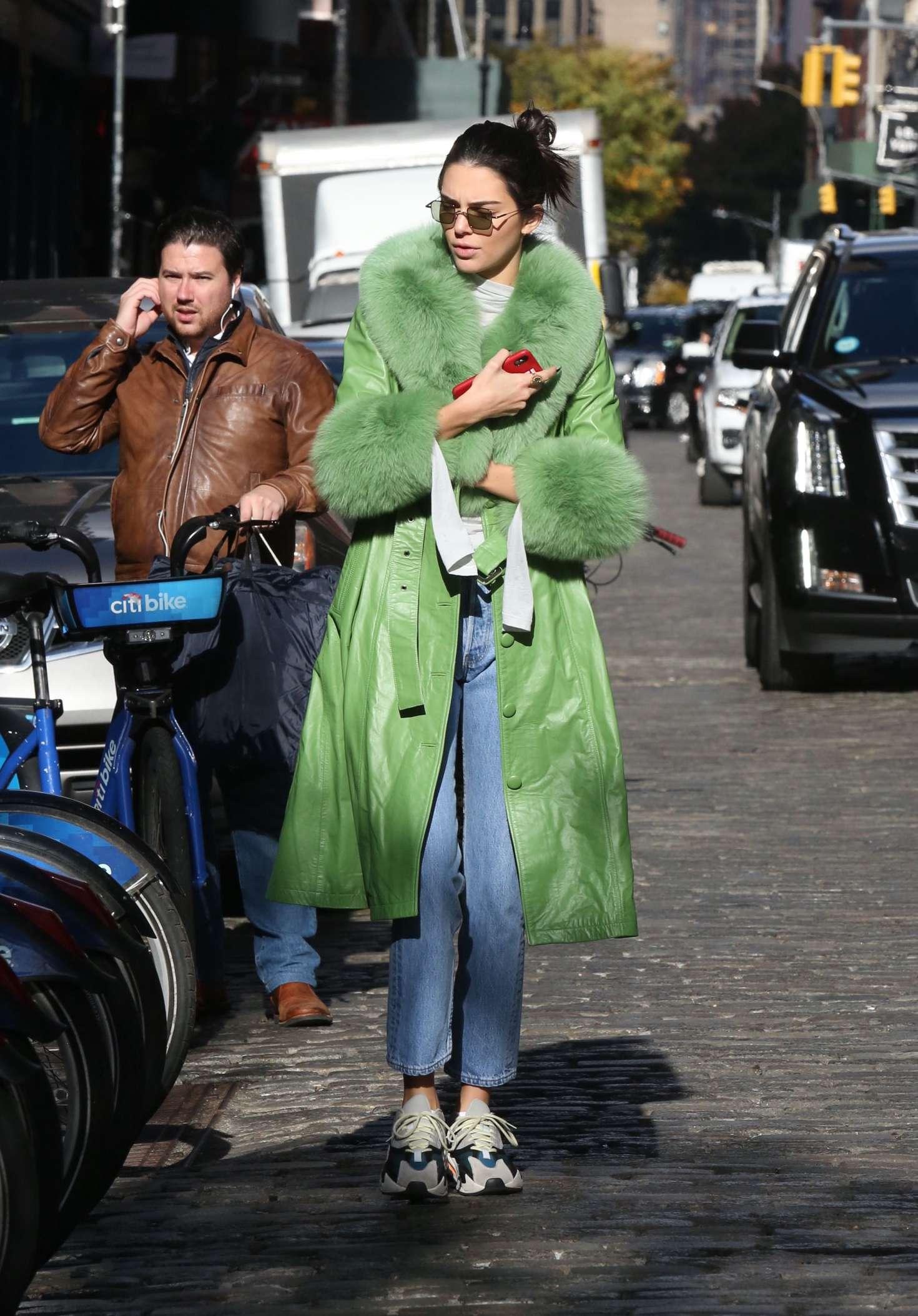 Kendall Jenner rocking a clinging light grey jumper with a turtleneck