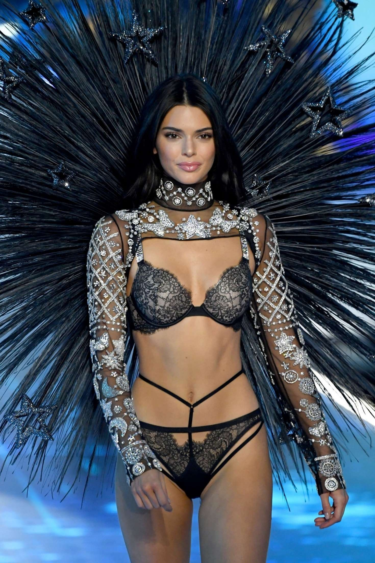 Kendall Jenner donning a slouchy black embellished Victoria's Secret crop jacket with a see-through fabric, full sleeves, studded and a turtleneck