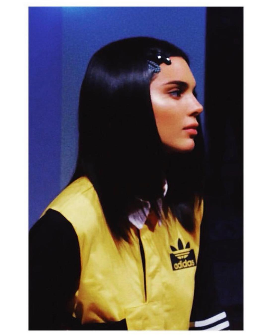 Kendall Jenner donning a clinging Adidas crop top with full sleeves, shirt collar and striped