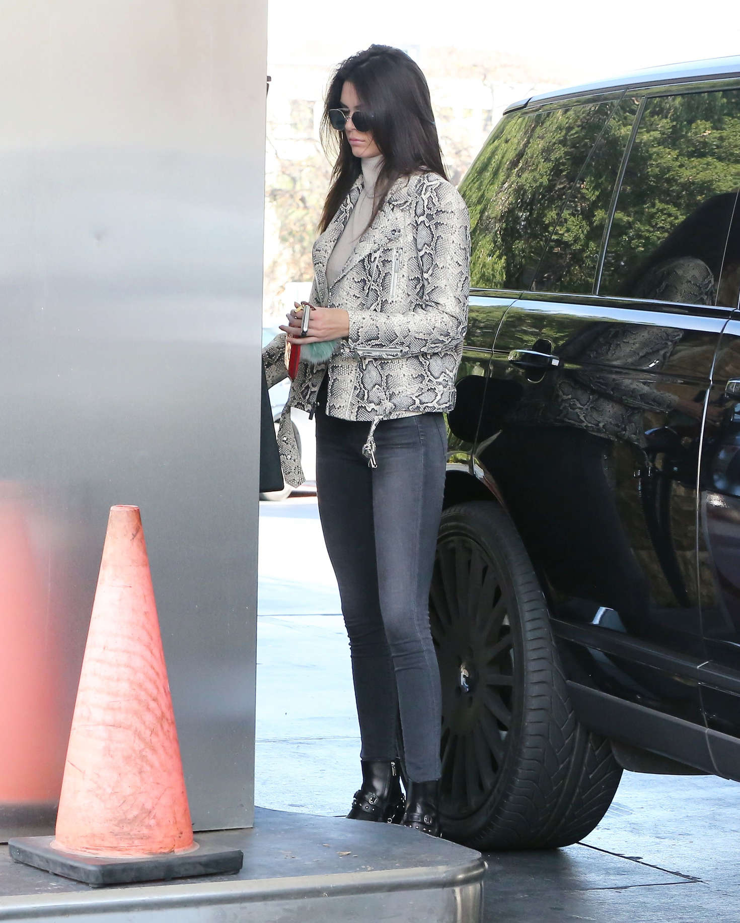 Kendall Jenner rocking a close fitting grey Jacket with a snakeskin fabric, full sleeves and a turtleneck
