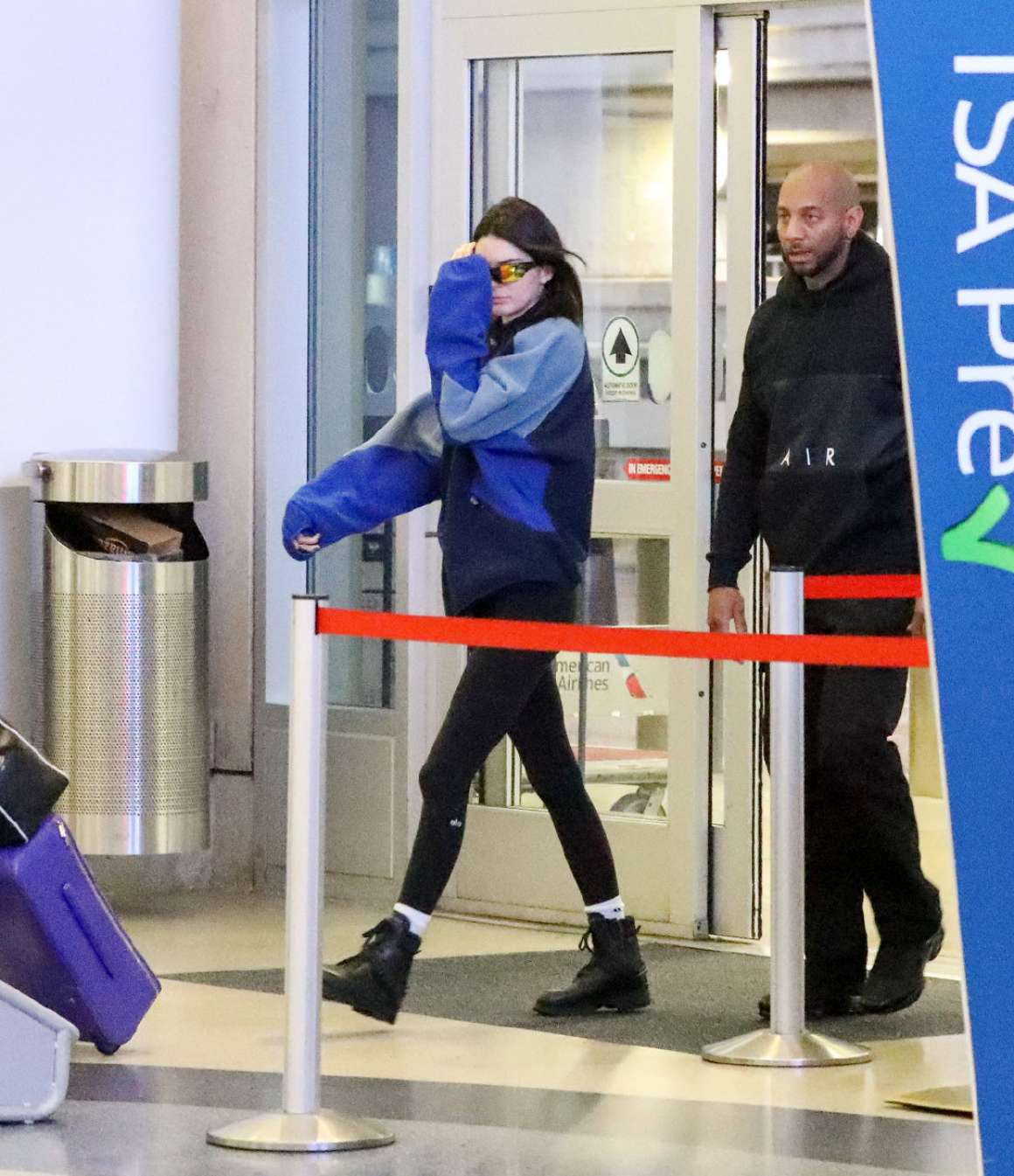 Kendall Jenner rocking a relaxed fit navy blue jacket with extra long sleeves and a turtleneck