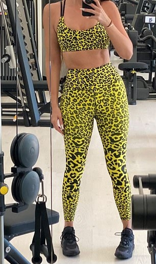 Khloe Kardashian wearing a Striking sun beam yellow Good American sports bra with a scoop neck and spaghetti straps
