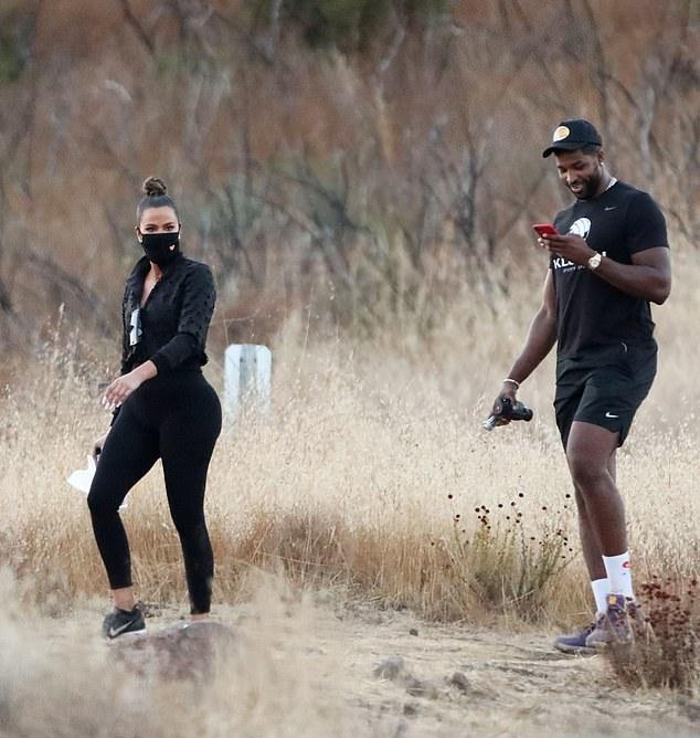 Khloe Kardashian wearing black mesh lace-up sneakers