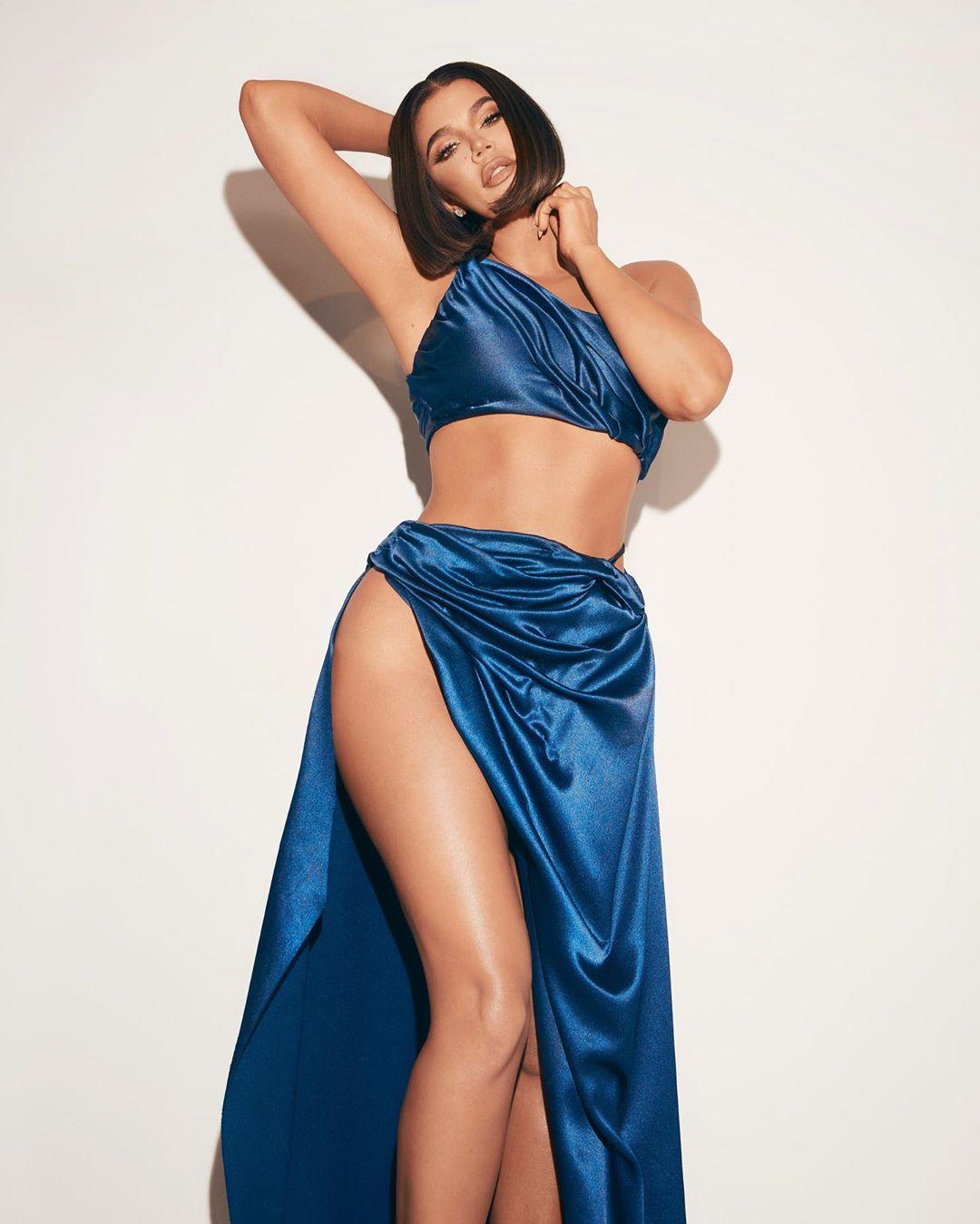 Khloe Kardashian donning a shiny blue slinky matching maxi skirt