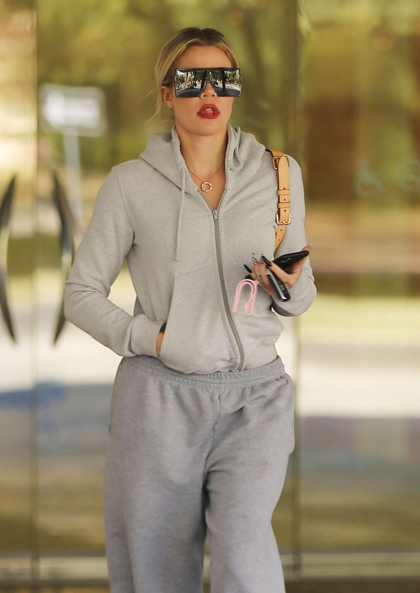 Khloe Kardashian rocking a Casual grey hooded crop jacket with extra long sleeves, side pockets and ribbed hem
