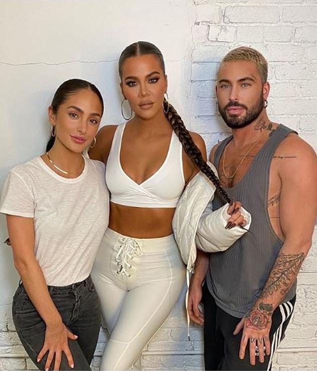 Khloe Kardashian donning skinny white lace-up jeggings with high waist