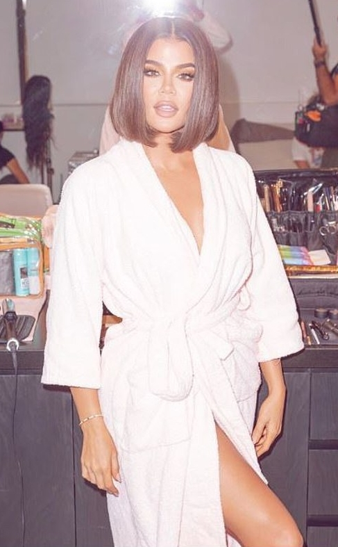 Khloe Kardashian wearing a White robe with 3/4 sleeves and knotted