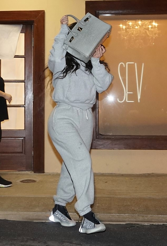 Kim Kardashian wearing Grey baggy matching sweatpants with side pockets, a woolen material and ribbed trim hem
