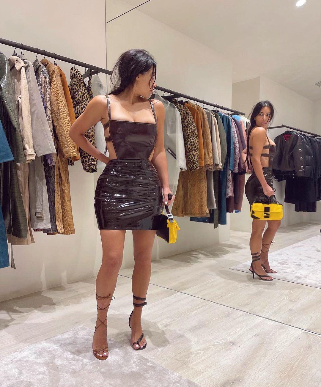 Kim Kardashian rocking round brown Bottega Veneta ankle sandals with high heel