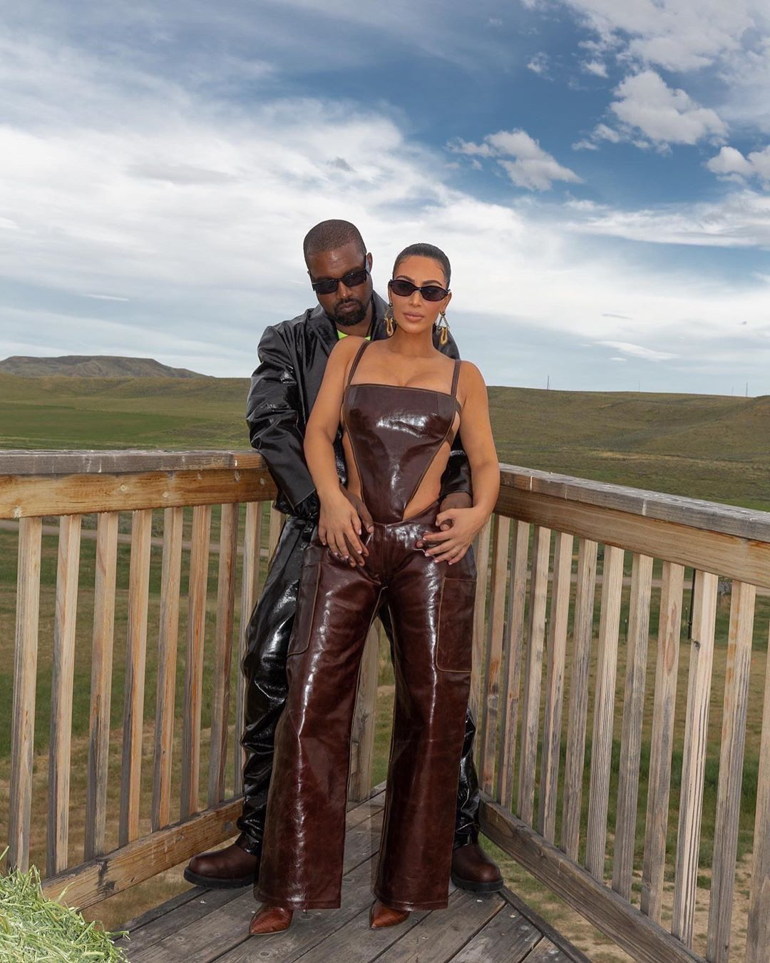 Kim Kardashian donning a Figure hugging shiny brown Mowalola jumpsuit with a leather fabric, cut out and spaghetti straps