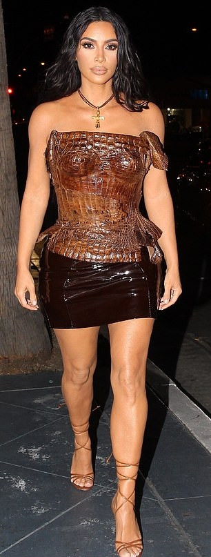 Kim Kardashian wearing a Formfitting brown snakeskin corset top with a snakeskin fabric and asymmetric hem