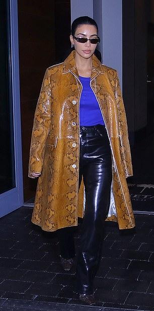 Kim Kardashian rocking narrow brown snakeskin boots with high heel